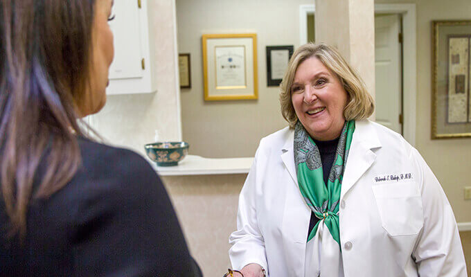 Happy patient talking to Dr. Deborah Bishop