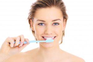 woman smiling, woman brushing her teeth, brushing teeth