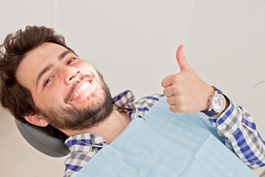 Man giving thumbs up at dentist