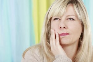 woman blonde severe tooth pain